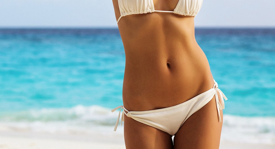 Get a tummy tuck in Mexico and flaunt your beach body!